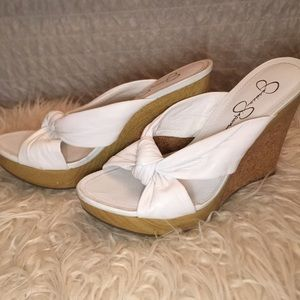 9594ba9401a Jessica Simpson Shoes - Jessica Simpson leather knot wedge